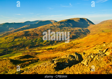 Evening view from Wansfell Lake District over the Troutbeck valley with Kirkstone Pass Red Screes and the Fairfield - Stock Photo