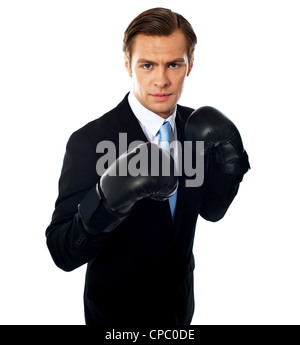 Handsome businessman posing in boxing gloves over white background - Stock Photo