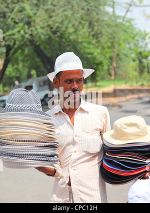 Hats seller in New Delhi - Stock Photo