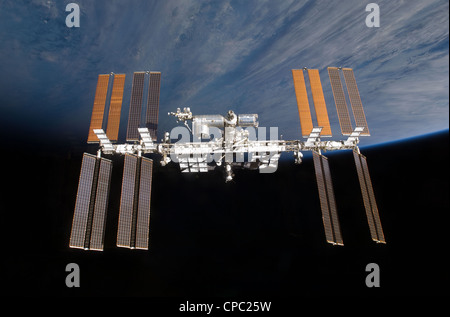 computer enhanced NASA image of International Space Station (ISS) flying above earth - Stock Photo