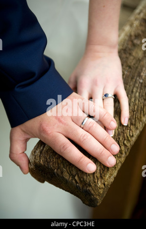 newly married couple's hands with their wedding rings