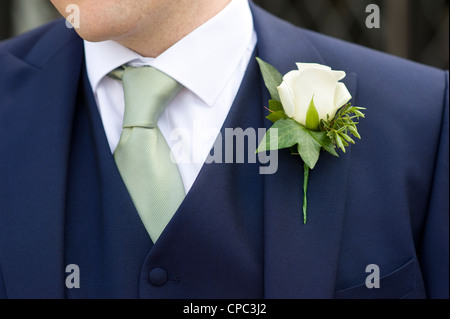 man at a wedding wearing a floral buttonhole - Stock Photo