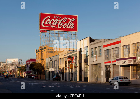 An antique Coca Cola sign on top of building - USA - Stock Photo
