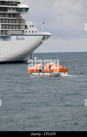cruise ship cruiseship ships lifeboat life boat lifeboats MSC marina being used to ferry pssengers on day trips - Stock Photo