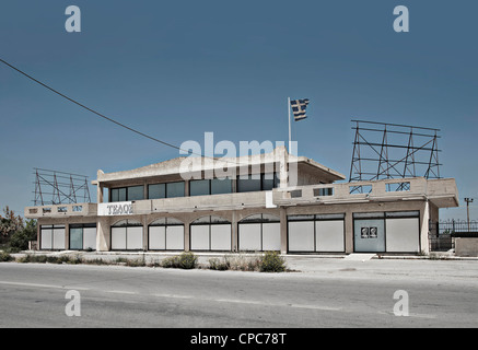Closed shop in Greece with torn ensign and bill that calls for strike. - Stock Photo