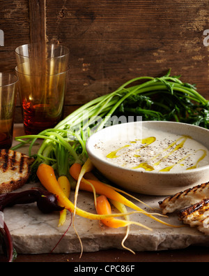 Bowl of bagnacauda and sandwiches - Stock Photo