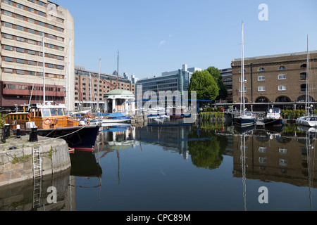 Buildings reflected in water of St Katharine Docks marina, east London - Stock Photo