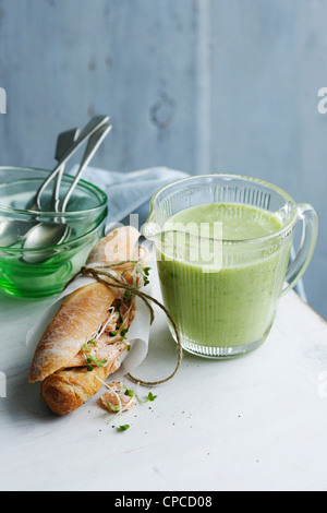 Jug of cucumber trout soup with sandwich - Stock Photo