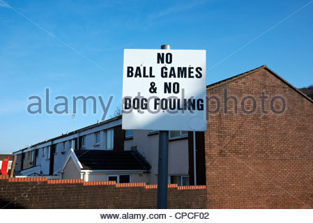 no ball games no dog fowling notice on a residential street in a council housing estate - Stock Photo