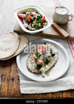 Plate of chicken souvlaki and tortilla - Stock Photo