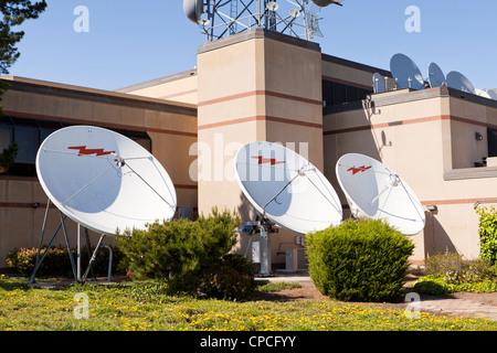 TV station satellite dishes - Stock Photo