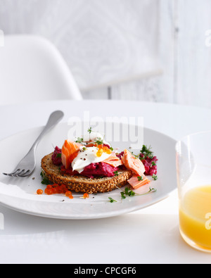 Plate of smoked trout with beetroot - Stock Photo