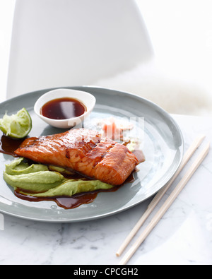 Plate of salmon and wasabi sauce - Stock Photo