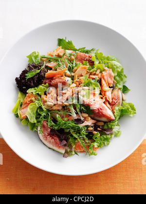 Plate of fish and fig salad - Stock Photo