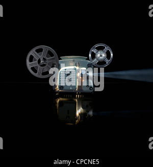 Glowing movie projector with reel - Stock Photo