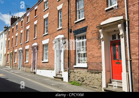 Terrace of red brick built houses with sash windows dating from the Georgian period in Ludlow Shropshire England - Stock Photo