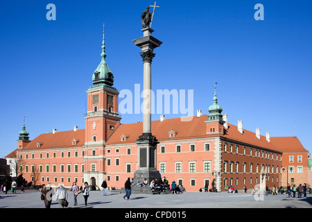 Sigismund's III Waza Column, Royal Castle and tourists on the Castle Square in Warsaw, Poland.