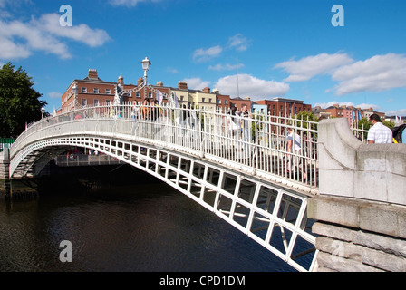 Halfpenny Bridge over River Liffey, Dublin, Republic of Ireland, Europe - Stock Photo