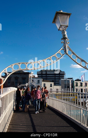 Halfpenny Bridge over River Liffey, Dublin,Republic of Ireland, Europe - Stock Photo