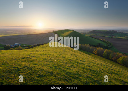 View from Corton Hill towards Parrock Hill and Cadbury Castle, Sunset. Somerset. England. UK. - Stock Photo