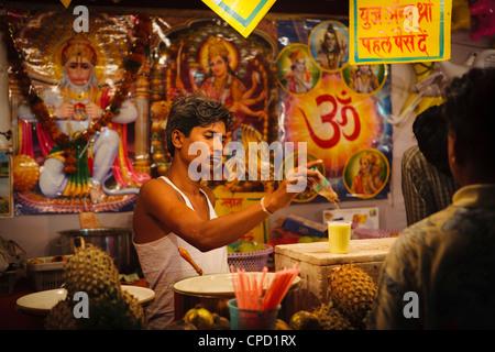 Hindu fruit juice stall at local rural fair, Sejpur, Gujarat, India, Asia - Stock Photo