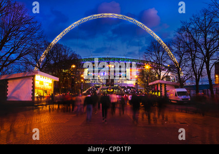 Wembley Stadium with England supporters entering the venue for international game, London, England, United Kingdom, - Stock Photo
