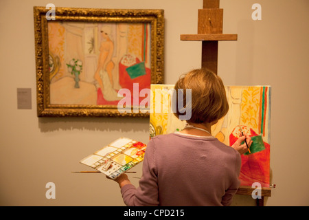 Lady copying a painting in the Orangerie Gallery, Paris, France, Europe - Stock Photo