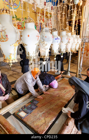 Church of the Holy Sepulchre with crosses and lanterns, the Stone of the Unction, Christian Quarter, Old City, Jerusalem, - Stock Photo