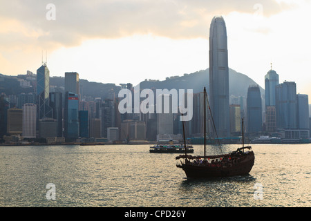 Star Ferry crossing Victoria Harbour towards Hong Kong Island, Two IFC Tower on the right, Hong Kong, China, Asis - Stock Photo