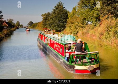 Canal boats idling their way down the Kennet and Avon Canal, Wiltshire, England, United Kingdom, Europe - Stock Photo