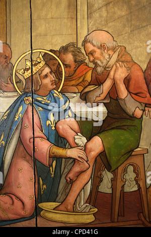 Painting depicting St. Louis washing a pauper's feet in Notre-Dame de Paris cathedral Treasure Museum, Paris, France, - Stock Photo