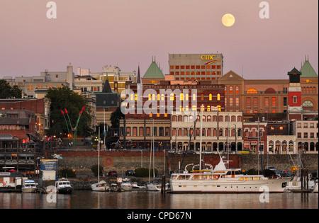 Full moon rising over Victoria city skyline-Victoria, British Columbia, Canada. - Stock Photo