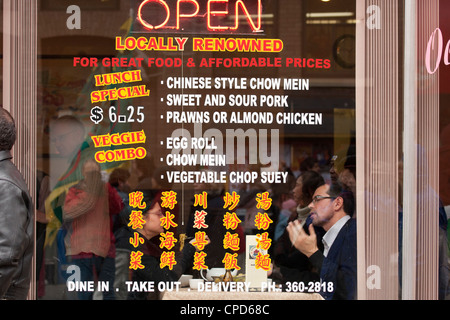Chinese food sign in restaurant window-Victoria, British Columbia, Canada. - Stock Photo