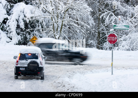 Traffic on snowy roads after winter blizzard-Victoria, British Columbia, Canada. - Stock Photo