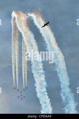 SOUTHPORT, ENGLAND - JULY 23: Hawk T Red Arrow jets from the British Air Force perform aerobatics and mid air stunts - Stock Photo