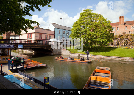 People punting on the river Cam at Magdalene Bridge, Cambridge UK - Stock Photo