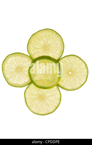 Five slices of lime as a pattern on a white background - Stock Photo