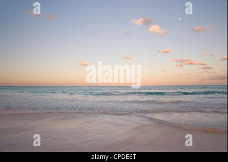 Clouds at sunset over Pink Sands Beach, Harbour Island, Eleuthera, The Bahamas, West Indies, Atlantic, Central America - Stock Photo
