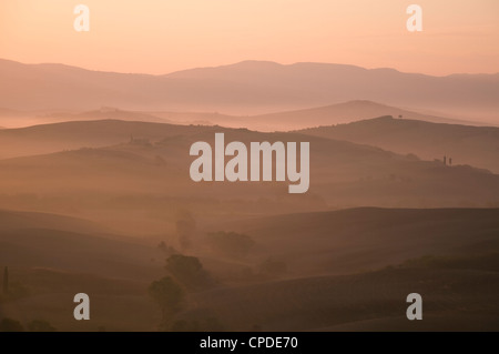 A dawn view over the misty hills of Val d'Orcia, UNESCO World Heritage Site, Tuscany, Italy, Europe - Stock Photo