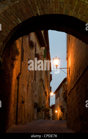 An early morning view through a stone arch in the hilltop town of Pienza, Val d'Orcia, Tuscany, Italy, Europe - Stock Photo