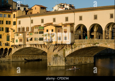 Rowers on the Arno River and gondolas moored underneath the Ponte Vecchio, Florence, Tuscany, Italy, Europe - Stock Photo