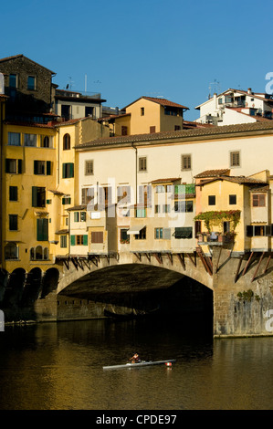 A rower headed under the Ponte Vecchio, Florence, UNESCO World Heritage Site, Tuscany, Italy, Europe - Stock Photo