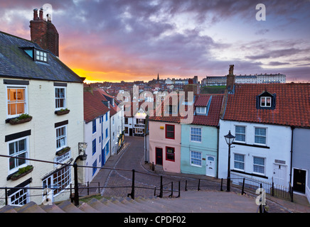 Whitby town houses at sunset from the Abbey steps, Whitby, North Yorkshire, Yorkshire, England, United Kingdom, - Stock Photo