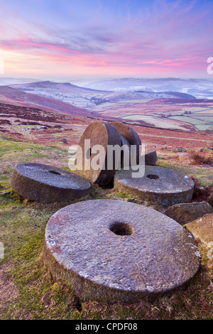 Stanage Edge wheelstones (millstones) and frosty winter moorland sunrise, Peak District National Park, Derbyshire, England, UK Stock Photo