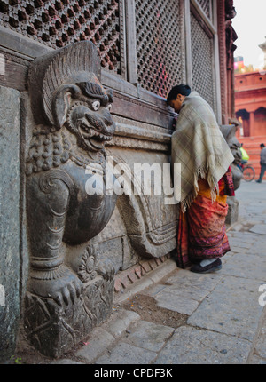 Stone lions guard a prayer wall in Durbar Square, Kathmandu, Nepal, Asia - Stock Photo