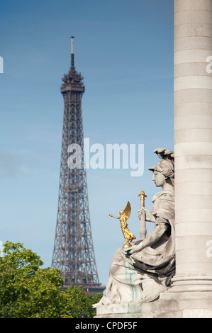Statue on the Alexandre III Bridge and the Eiffel Tower, Paris, France, Europe - Stock Photo