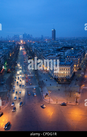 Avenue de la Grande Armee at night with La Defense in the distance from the Arc de Triomphe, Paris, France, Europe - Stock Photo