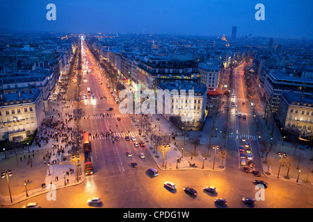 The Champs Elysees at night from the Arc de Triomphe, Paris, France, Europe - Stock Photo