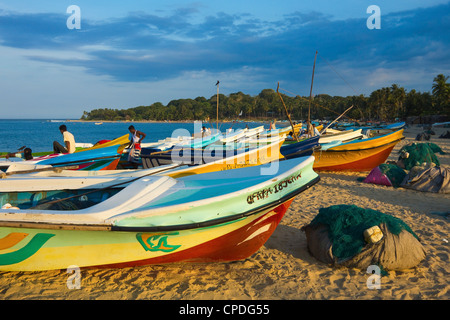 Newer post 2004 tsunami foreign-donated fishing boats on this popular surf beach, Arugam Bay, Eastern Province, - Stock Photo