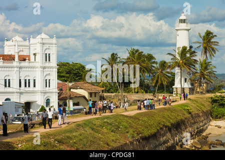 Meeran Jumma Mosque and the lighthouse at the Point Utrecht Bastion in the old Dutch Fort, Galle, Southern Province, - Stock Photo